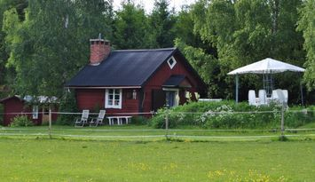 Idyllisk timmerstuga i Stängnäs