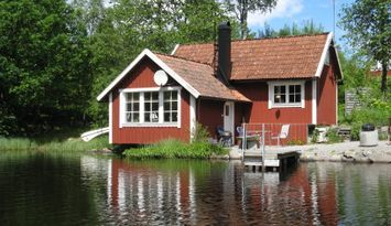 Cottage in smaland on the shore of a lake, sauna