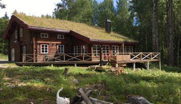 Stort Timmerhus vid sjö, Arvika, Värmland.