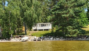 Summer house by lake Östra Laxsjön