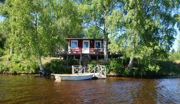 Semesterhus vid sjön Sörälgen