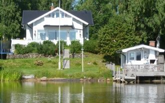Big Summerhouse, own beach, motorboat included!