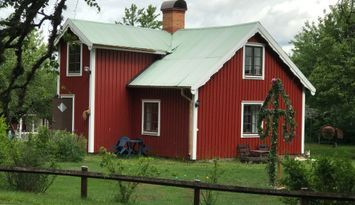 Red house with white corners