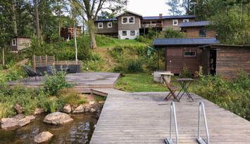 Big summer house by the beach with private jetty