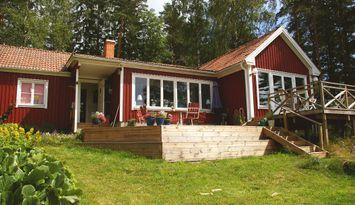 Hus med utsikt över havsvik, vissa veckor sommaren