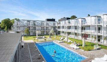 Central lägenhet i Visby, tillgång till pool