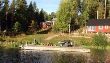 Ferienhauser + Boot auf einer Insel im Runn.See